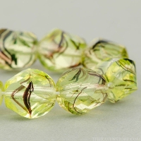 Spiral Faceted Round (10mm) Yellow Uranium with Purple Stripe Transparent