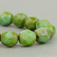 Round Faceted (6mm) Turquoise Green Opaque with Picasso