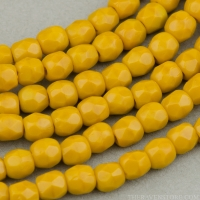Round Faceted (3mm) Mustard Orange Opaque