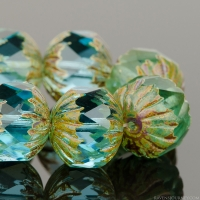 Center Faceted Round (11x10mm) Aqua Blue Transparent with Picasso Finish